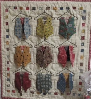 tiny quilt with vest that open on embroidered hangers