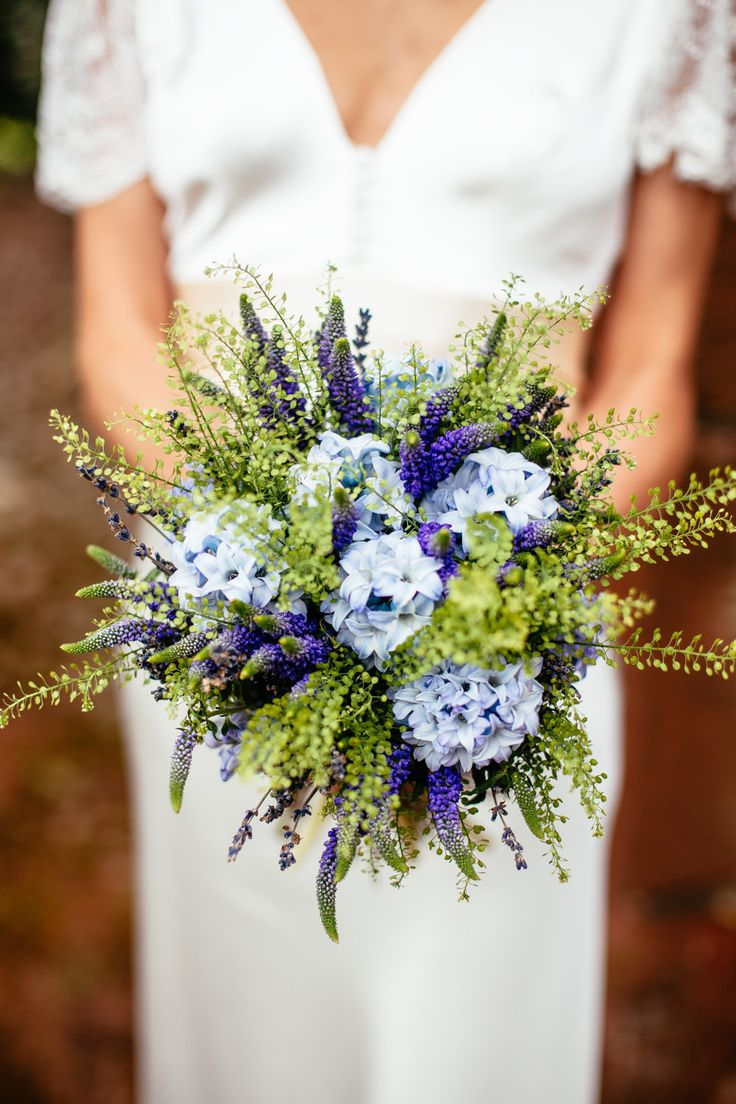 Blue hyacinths & lavender wild flower bouquet tied with twine -   Image by Cassandra Lane Photography - A Charlie Brear lace and silk dress for a west midlands vintage DIY barn wedding with a blue colour scheme and photography by Cassandra Lane