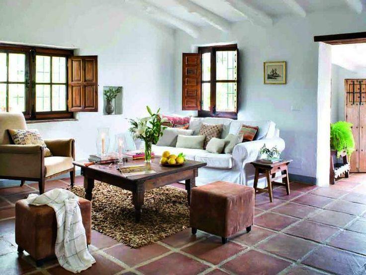 Decorado con muebles rústicos y toques actuales como el sofá ,la alfombra  pufs de cuero.