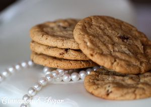 Chocolate Almond Crisps are crispy on the outside yet soft on the inside. Chocolate chips are the natural compliment to the almond butter flavored cookies. Recipe shared with permission granted by Kensington Publishing & Joanne Fluke, author of WEDDING CAKE MURDER.