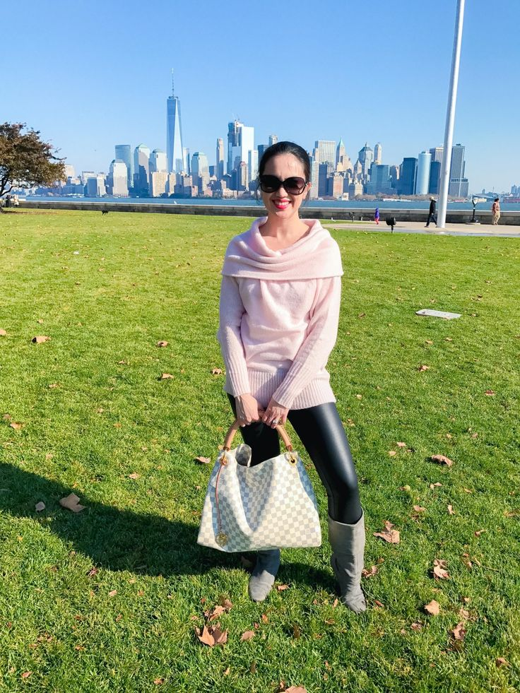 woman in Ellis Island, New York wearing blush Express off the shoulder top sweater, black faux leather leggings, gray suede rockport boots, tiffany & co. sunglasses, and louis vuitton artsy in damier azur - fall fashion outfits, fall style for women; Easy everyday outfits for women