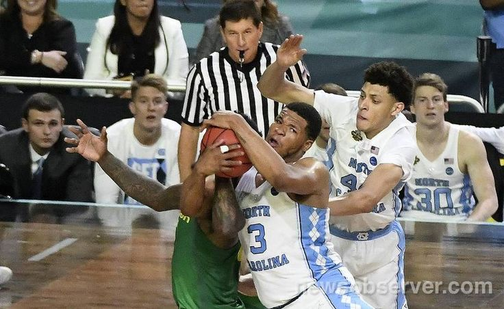 UNC forward Kennedy Meeks (3) grabs the final rebound of the game from Oregon forward Jordan Bell (1) after the Tar Heels missed four free throws in a row. The Tar Heels UNC defeated Oregon 77-76 Saturday, April 1, 2017 at the NCAA Final Four semi-final game in Glendale, Az. in the University of Phoenix Stadium. The Tar Heels will play the Gonzaga Bulldogs for the National Championship Monday night.