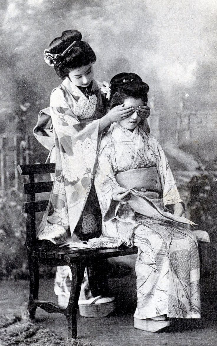 """Two Hangyoku (Young Geisha) from Tokyo playing a game of """"guess who?"""" ~1910s"""
