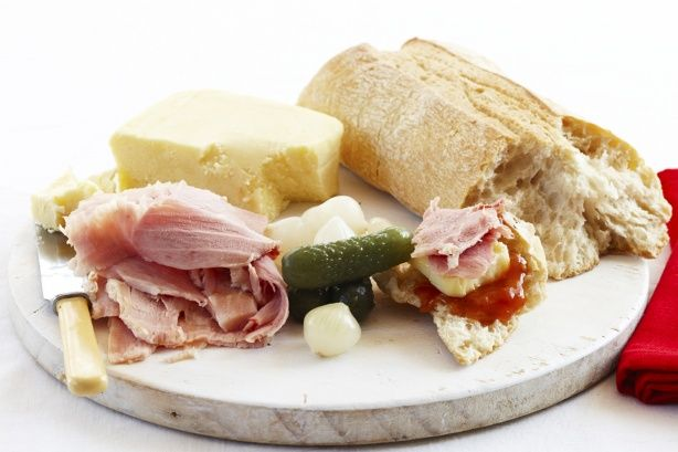 Ploughman's lunch. This traditional platter features crusty ciabatta bread, cheese, ham, pickled onions, tomato chutney and red peppers.