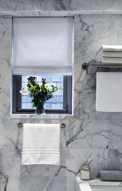 Bathroom in Statuary Marble by Katch I.D. Interiors.