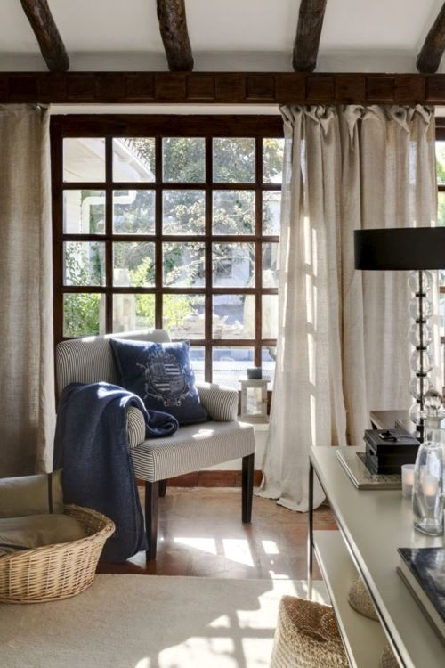 What's not to love about this room? The chair, the pillow, the curtains, the ceiling, the window--perfect.