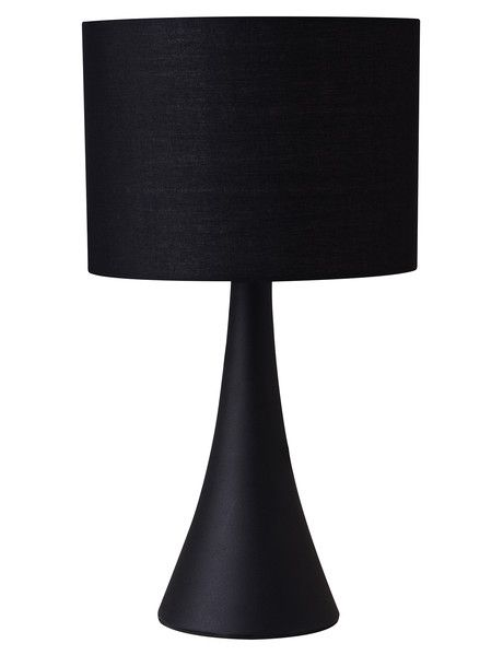 The Kit My Home Trapeze Lamp features a classically shaped ceramic base, with a round fabric shade. It is available in black and white (each colour sold separately).