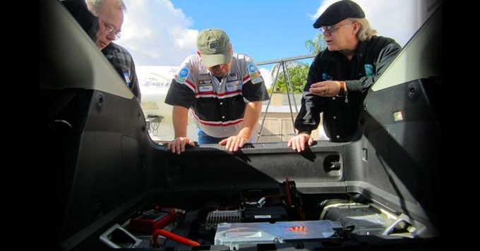 This auto mechanic is ready for an electric vehicle revolution He's teaching others how to fix hybrid and electric cars.