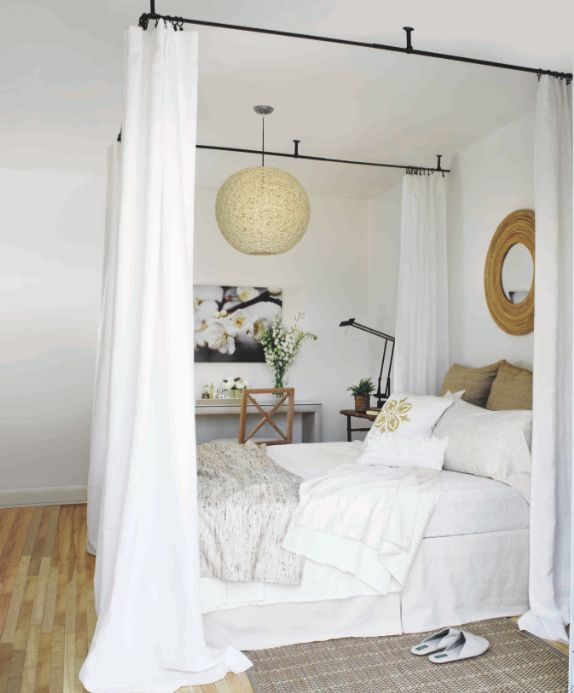 Bedroom with ceiling-mounted curtains around bed, by Margot Austin. Gorgeous and practical.