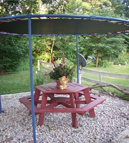 make an old trampoline a shade for the backyard!   Description: Check out Lowe's Idea Exchange today to see more inspiring projects.