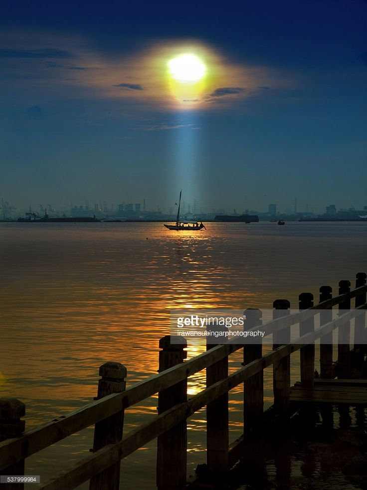 A ray of light fall on a boat as a morning blessed sometimes in Ancol beach Jakarta.