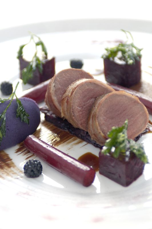 Loin of venison with pancetta, violet potato, spiced red cabbage, braised salsify in red wine, bitter chocolate  and port sauce recipe by professional chef Alan Murchison