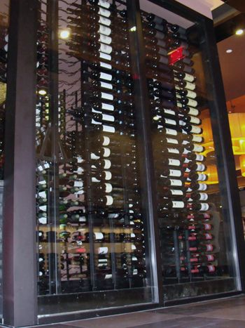 The 10' High Glass Wine Cellar at the Capital Seafood Restaurant in Irvine California. Coastal designed and created this wine cellar for commercial purposes. Check out our commercial wine racks here http://www.wineracksbycoastal.com/category.aspx?categoryID=3. Coastal Custom Wine Cellars  26222 Paseo Toscana San Juan Capistrano, CA 92675  California Office: +1 (949) 355-4376