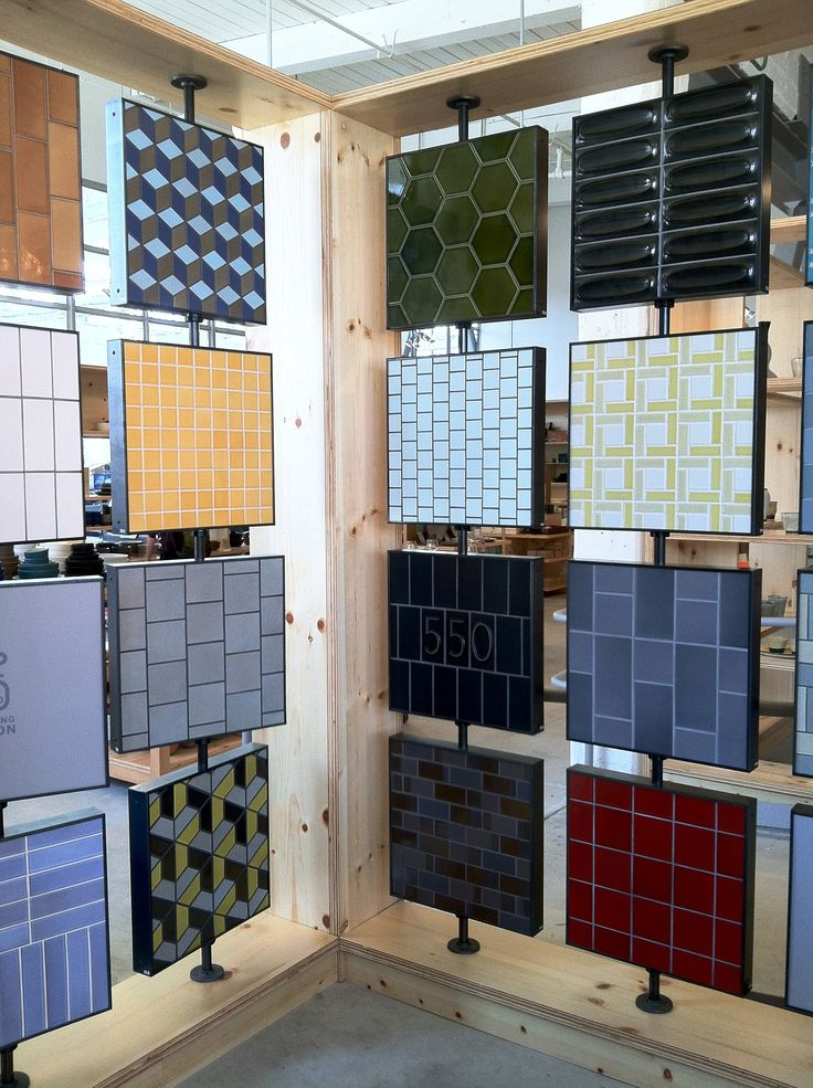 a great way to display tile boards they spin - Interior Design Tiles Showroom