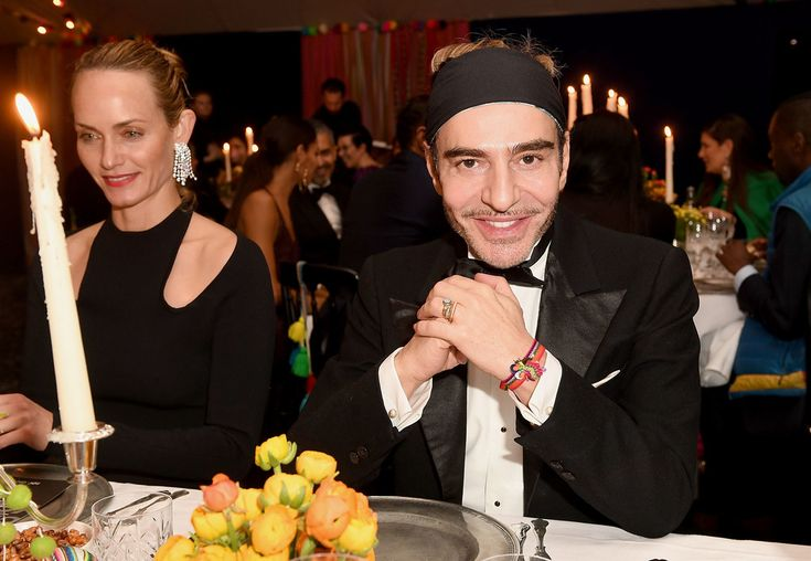 Amber Valletta and John Galliano attend the gala dinner as The Business of Fashion Presents VOICES on December 2, 2016 in Oxfordshire, England.