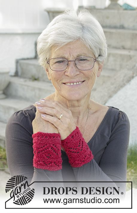 Holiday Plans wrist warmers with lace pattern by DROPS Design. Free Knitting Pattern