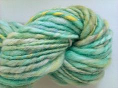 Aqua, lime and lemon chunky spun. Hand spun, hand painted art yarn. Pure Australian 21 micron merino wool.