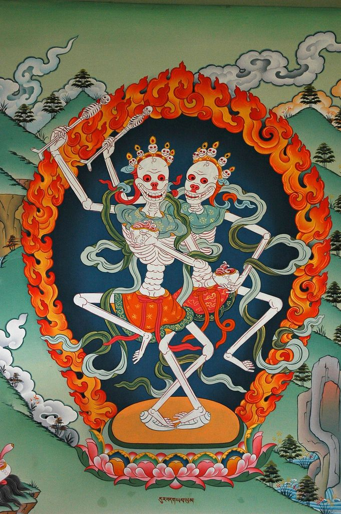 """Kinkara, Citipati, The Dancing Enlightened Skeletons, Lords of the Cemetery, Pharping in the Gelugpa Monastery on the hill below Padmasambhava's cave, Nepal.In Tibetan Buddhism, the Citipati, or """"Lords of the Cemetery"""" are two mythological Buddhist ascetics, who were so deep in their meditation, they were caught unawares by a thief and beheaded even before they knew they were dead. As a symbol, the Chittipati represent the eternal dance of death, and perfect awareness. They are usually…"""