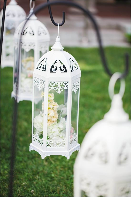 flower filled lantern aisle decor #weddingceremony #aisledecor #weddingchicks http://www.weddingchicks.com/2014/03/19/seaside-manor-wedding/