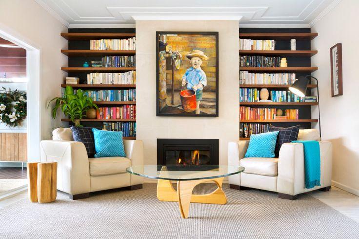 Built-ins + bookshelves. Black walls with warm wood shelves. Michelle Walker Architects