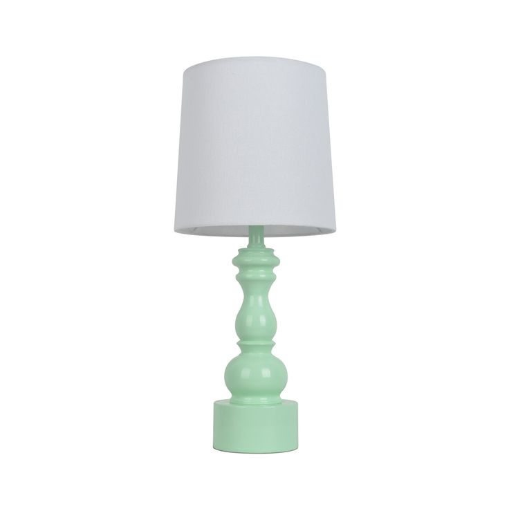 Capture classic, traditional stylings in the Turned Table Lamp Touch Control Mint from Pillowfort. This traditional lamp has a look-at-me mint color with a barrel shade.