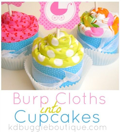 Baby Burp Cloth Cupcakes Tutorial - <3 the cupcake topper. You could also use a punch to decorate the paper you put around to hide the rubber band. Love this idea! Turned out cute, but next time I'll use receiving blankets