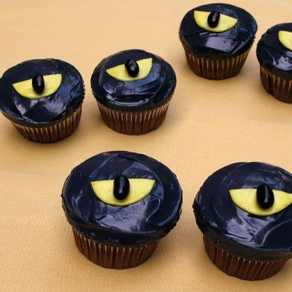 Snow White's Frightful Forest Eyes  These spooky eyes are far from an omen – they're delicious treats from the oven! Bake creepy, candy-laden cupcakes that'll fly off of the plate.