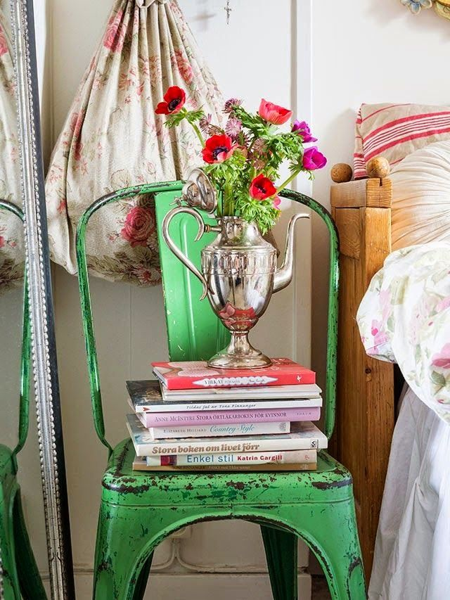 love the chair as a side table, perfect with silver coffeepot vase and flowers!