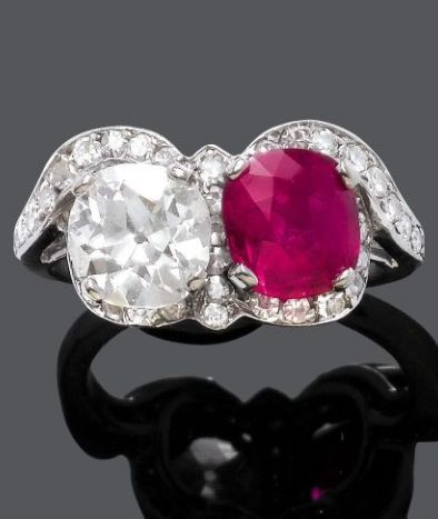 BURMESE RUBY AND DIAMOND RING, ca. 1920. Set with one oval Burmese ruby weighing 2.20 cts, and one cushion-cut diamond weighing 1.50 cts, surrounded by small diamonds, mounted in platinum. #ArtDeco #Vintage #ring
