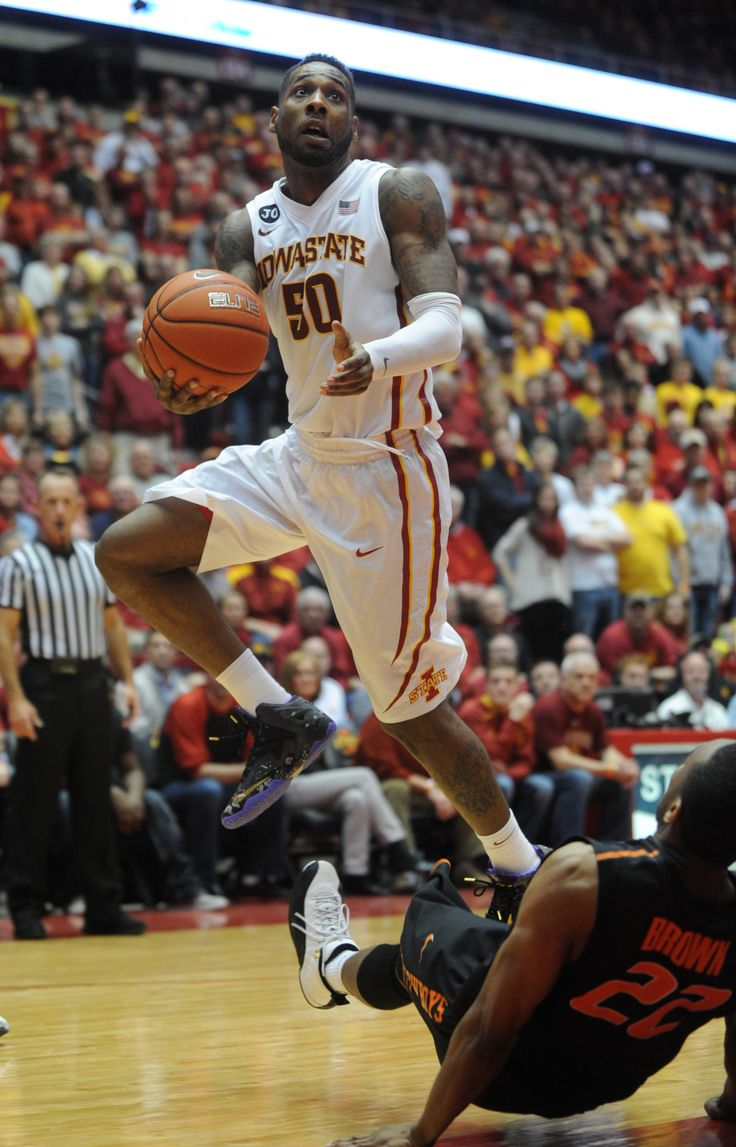 Iowa State's DeAndre Kane lays up the ball over Oklahoma State's Markel Brown during overtime at Hilton Coliseum on Saturday, March 8, 2014. Photo by Nirmalendu Majumdar/Ames Tribune