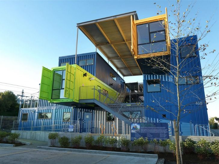 the box office recycles 32 shipping containers into 12 colorful offices in providence boxed ice office exterior
