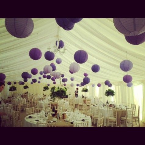 These purple lanterns are ok, but it would really take away from the tuscan feel. Thats why I want to stick with white lanterns, cream colored lace balls, and then do softer purples and greens in the yarn balls...with some twine balls too to bring back the natural feel.   This is too matchy matchy.