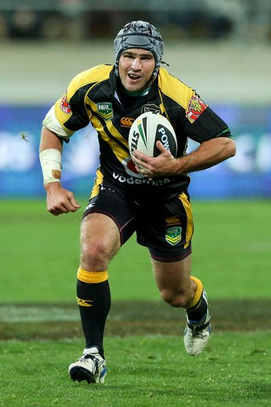 Nathan Friend of the Warriors runs the ball during the round nine NRL match between the New Zealand Warriors and the Canterbury Bulldogs at Westpac Stadium on May 11, 2013 in Wellington, New Zealand.