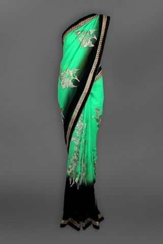 Featuring this beautiful Green & Black sari in our wide range of Saris. Grab yourself one. Now!