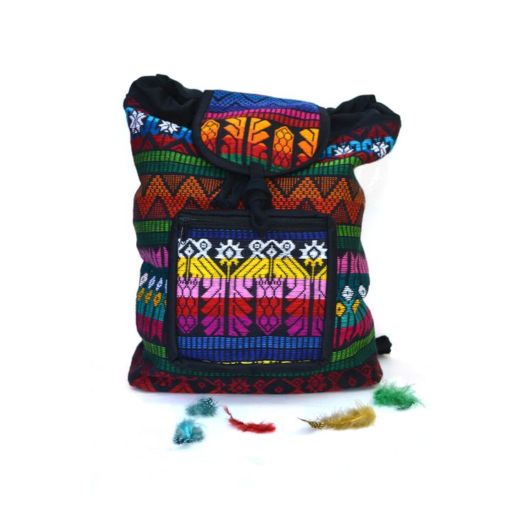 MAYA...This embroidered Guatemalan cinch-top backpack is sure to become a favorite of your trend-setting tot on the go. Chances are good, you'll be borrowing it yourself...Details:- Front zippered pocket- Cinch-top closure- Interior lining- Adjustable tied straps- 100�0cotton *Please note - these are handmade items. All backpacks are made in a similar color story but each bag has variations in overall color / pattern / fabric placement.Measurements:...