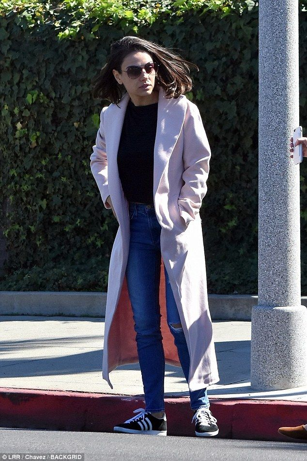 Pretty in pink! Mila Kunis took some time for herself to enjoy the outdoors before a prope...