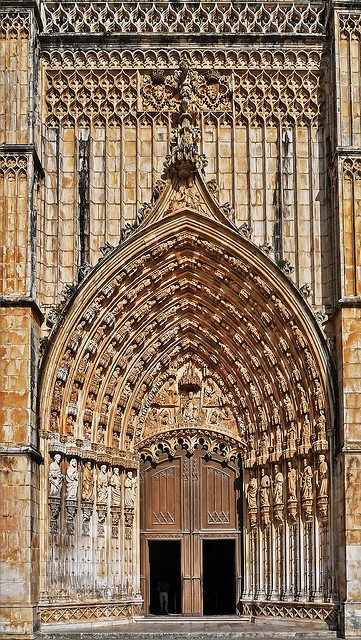 Portugal. Batalha Monastery, main door with an amazing carved stone frame