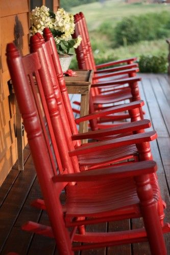 Red rocking chairs - love rocking chairs on the front porch...but being red makes them even better!