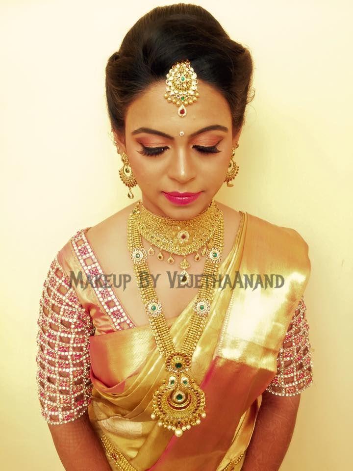 Traditional, Southern Indian bride, Geetanjali wears bridal silk saree and jewellery for her Reception. Makeup and hairstyle by Vejetha for Swank Studio. #BridalSareeBlouse #SariBlouseDesign #maangtikka  Golden silk kanchipuram sari. Tamil bride. Telugu bride. Kannada bride. Hindu bride. Malayalee bride  Find us at https://www.facebook.com/SwankStudioBangalore
