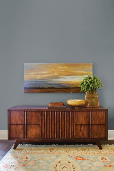 love this dusky blue grey paint  . Montpelier from Benjamin Moore.  living room a little lighter