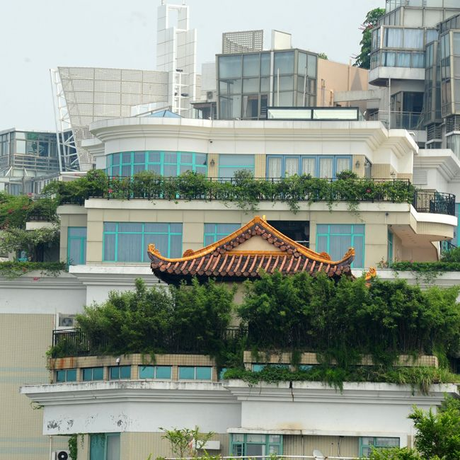 Neighbors suspect temple on the roof of fancy building isn't legal