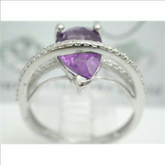 NWOT Genuine amethyst platinum over S. Silver ring ~~ NEW beautiful, genuine amethyst ring  beautifully cut with unique layer design.  ~~See the detail tag.  ~~Platinum over .925 sterling silver w amethyst makes this an excellent choice in beauty, style and value  ~~Brand new & beautiful. Pics just cannot do this justice.  Thank you. Jewelry Rings