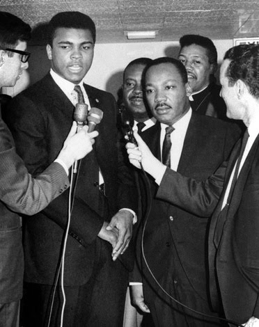 Muhammad Ali refuses draft induction 04/08/1967. Civil rights activist Martin Luther King, Jr. also in picture.