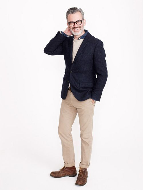 Consider wearing a navy wool suit jacket and khaki casual pants for a dapper casual get-up. This outfit is complemented perfectly with brown leather casual boots.   Shop this look on Lookastic: https://lookastic.com/men/looks/blazer-crew-neck-sweater-denim-shirt/22252   — Navy Denim Shirt  — Beige Crew-neck Sweater  — Navy Wool Blazer  — Khaki Chinos  — Brown Leather Casual Boots