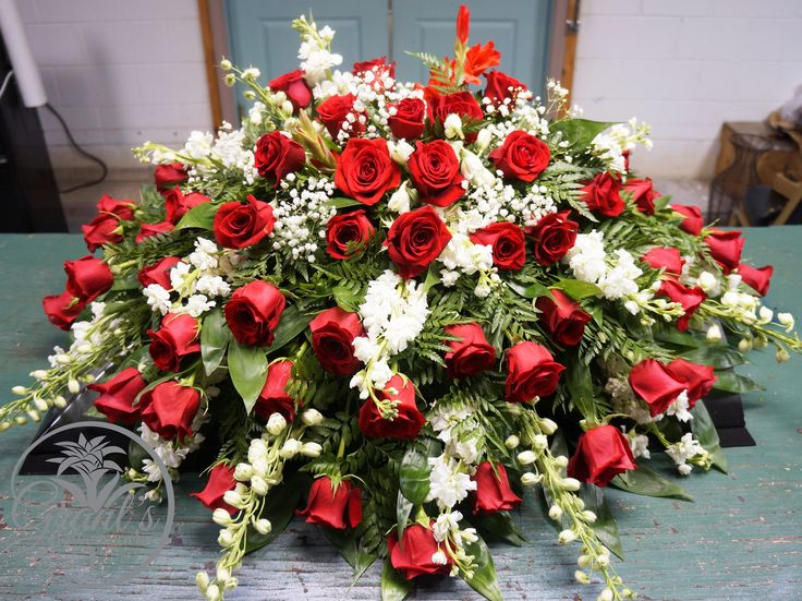 Casket Spray Red Roses, White Delphinium and other flowers