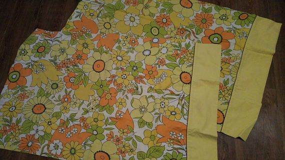 Wabasso Marvel Press Pillowcases / flower power / hippy daisies / 1960 / 1970 / yellow , orange , green and black Check out this item in my Etsy shop https://www.etsy.com/ca/listing/508104884/wabasso-marvel-press-pillowcases-flower