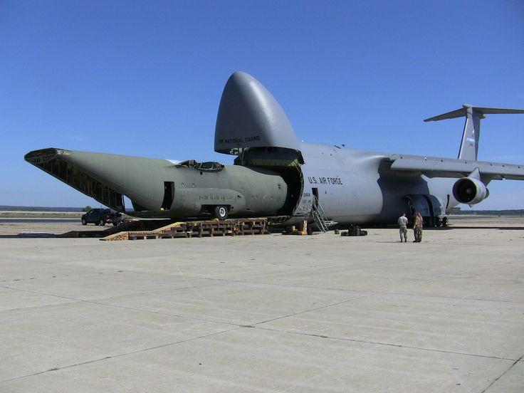 A big Lockheed eating a little Lockheed - C-5 Galaxy and C-130 Hercules cargo planes.