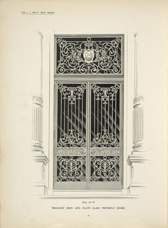 Wrought iron and plate glass vestibule doors.