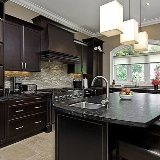 Dark cabinets with light tile floor kitchen dining for Black kitchen cabinets with dark floors