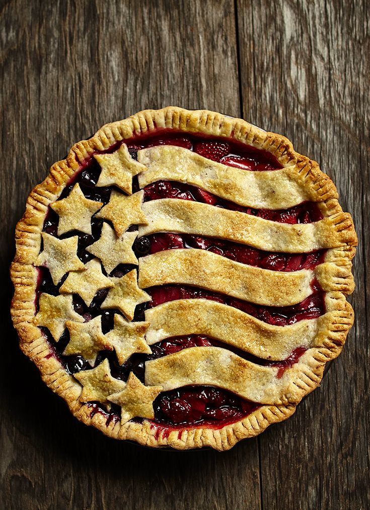 Fresh blueberries, strawberries and raspberries and a flaky butter and almond crust create a delicious patriotic pie. This dessert is perfect for Fourth of July parties!